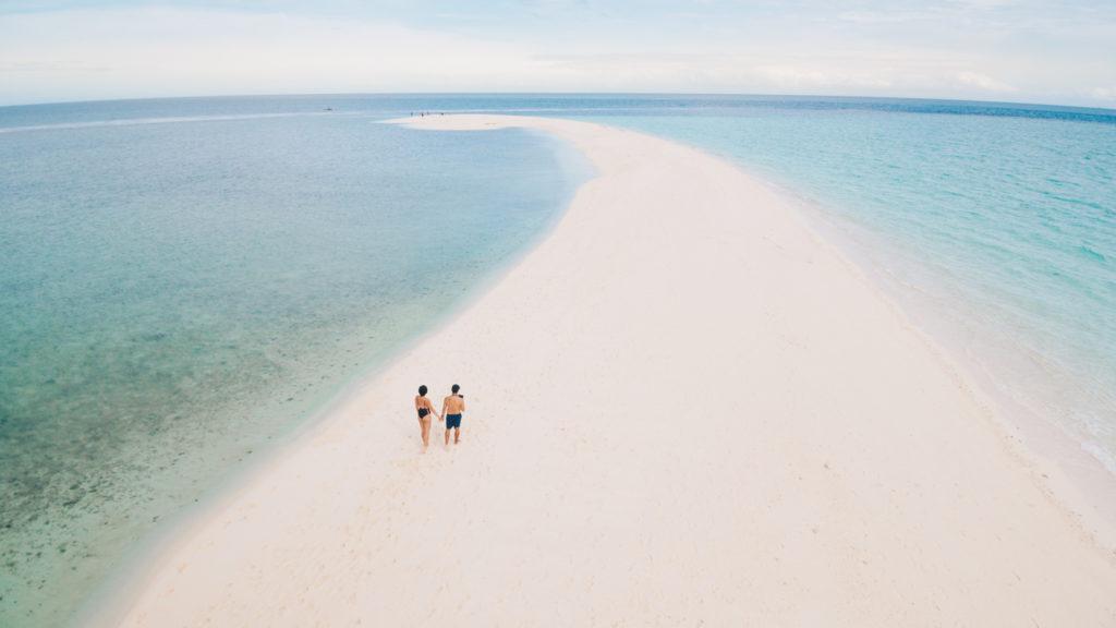 Travel couple on White island drone shot
