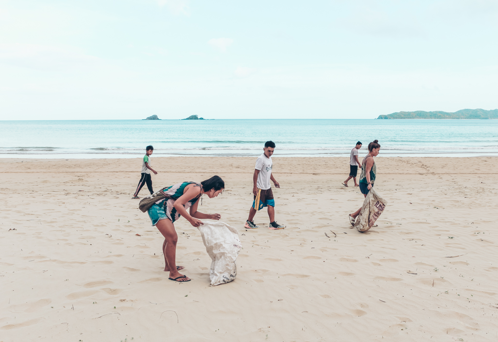 volunteers on Nacpan beach picking up rubbish
