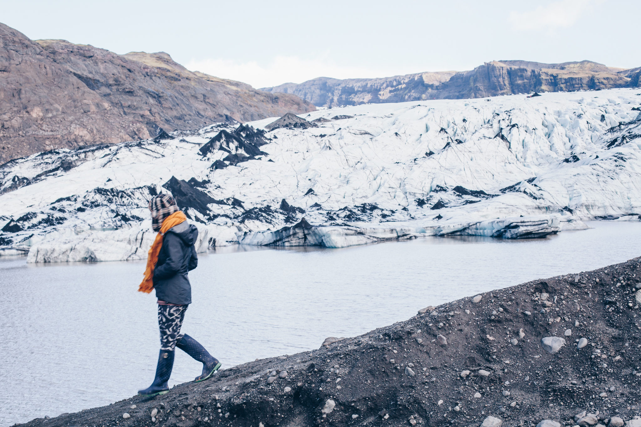 woman walking over the Iceland glacier