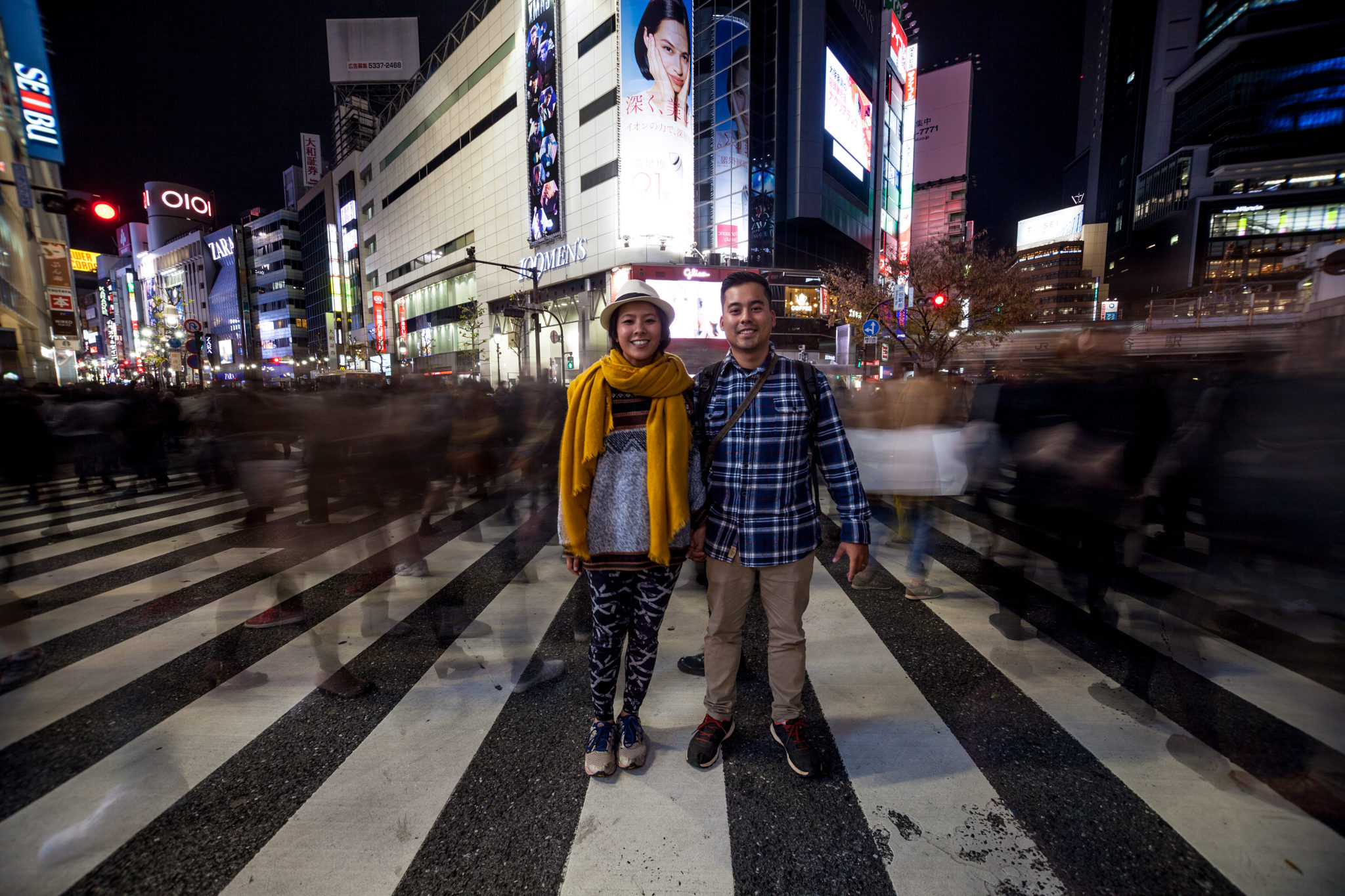 travel couple at the Shibuya crossing