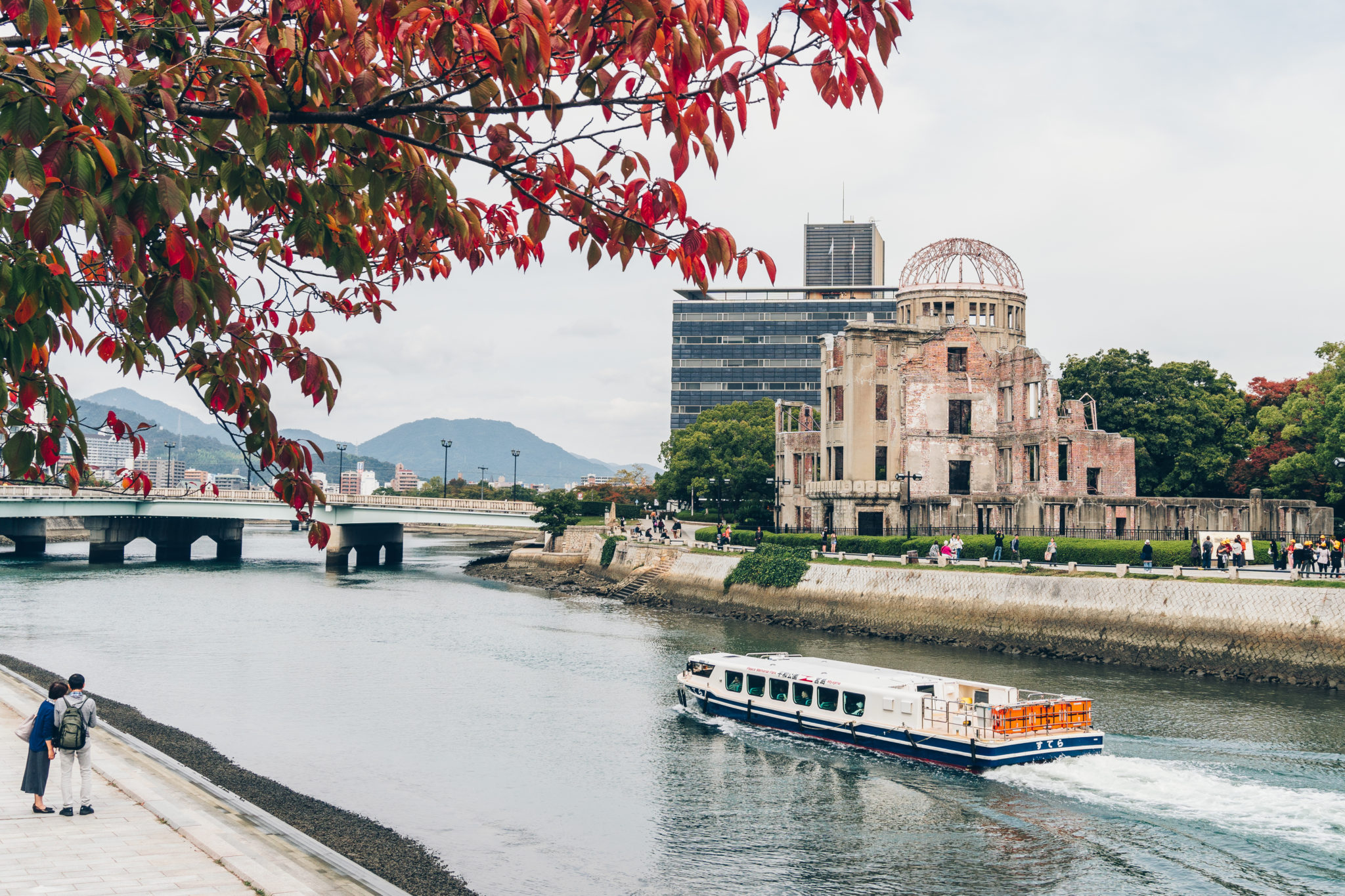 A ferry boat cruising between the Peace Memorial Park and the Atomic bomb dome in Hiroshima